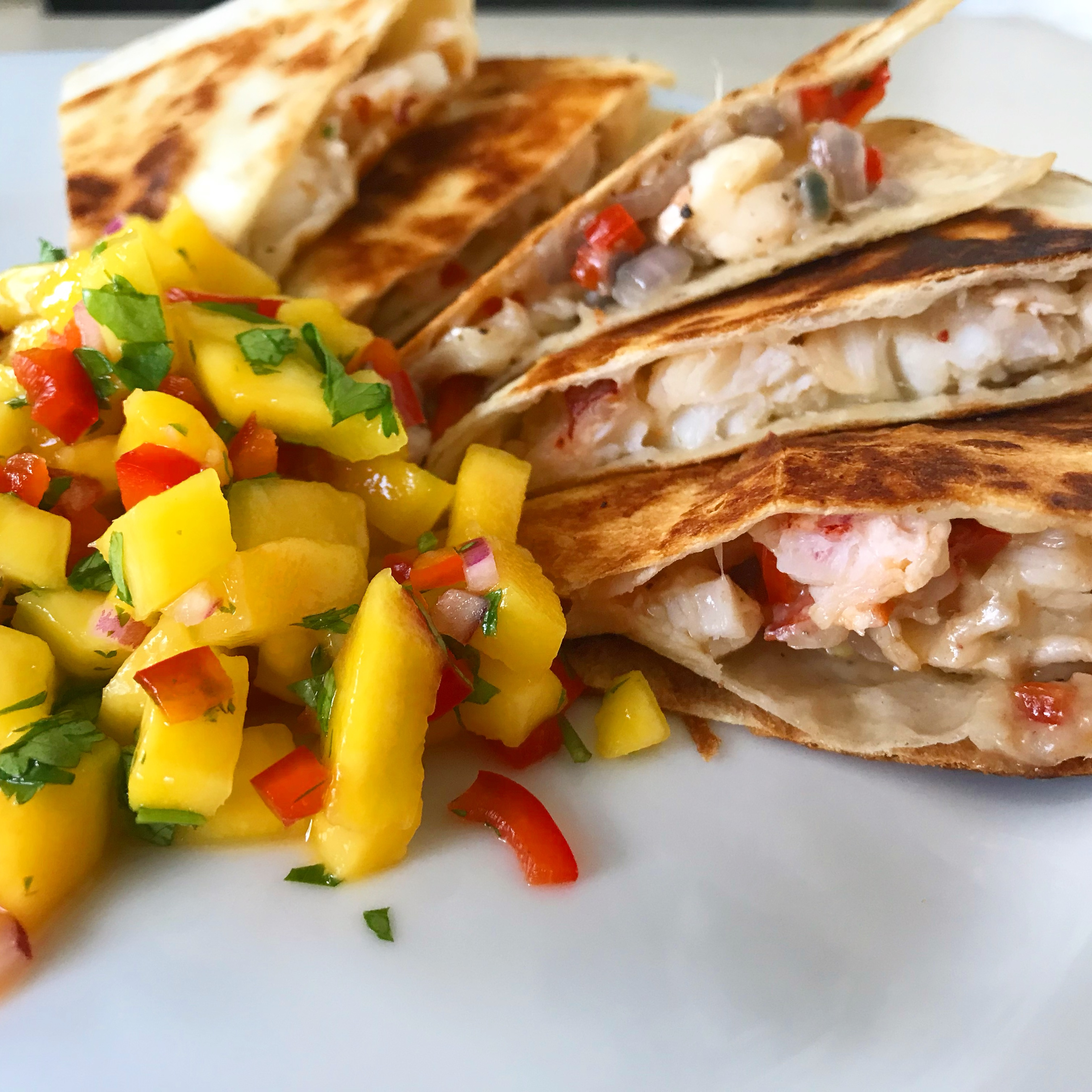 How to Make Zesty Lobster Quesadillas with Mango Salsa